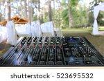 audio mixer in wedding ceremony | Shutterstock . vector #523695532