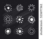 hand drawn suns on chalkboard... | Shutterstock .eps vector #523697362