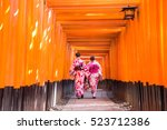 Women Geishas Among Red Wooden...