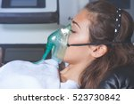 young woman with oxygen mask at ... | Shutterstock . vector #523730842