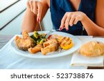 Girl Eating Fish For A Lunch I...