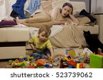 mother sitting on the couch.... | Shutterstock . vector #523739062
