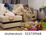mother sitting on the couch.... | Shutterstock . vector #523739068