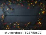 glowing christmas tree garland... | Shutterstock . vector #523750672