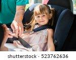 man buckling seat belt in... | Shutterstock . vector #523762636