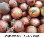 onion harvest.fresh golden...   Shutterstock . vector #523771006