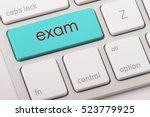 exam word written on computer... | Shutterstock . vector #523779925