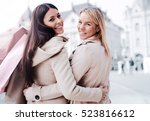 two attractive young women... | Shutterstock . vector #523816612