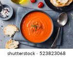 tomato soup in a black bowl on... | Shutterstock . vector #523823068
