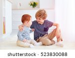 cute brothers playing together... | Shutterstock . vector #523830088