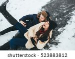 man and woman riding on the ice ... | Shutterstock . vector #523883812