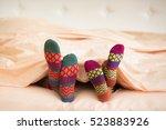 couple in christmas socks in... | Shutterstock . vector #523883926