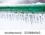frozen icy down pipe  icicles   Shutterstock . vector #523886062