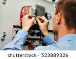 electrician near the low... | Shutterstock . vector #523889326