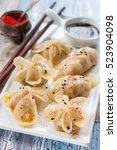 chinese steam dumplings   gioza ... | Shutterstock . vector #523904098