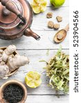 kettle with herbal tea with... | Shutterstock . vector #523904566