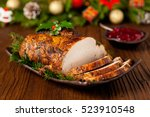 roast pork loin with christmas... | Shutterstock . vector #523910548