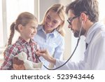 Small photo of Beautiful young mother and her little daughter at the pediatrician. Doctor is examining little patient using a stethoscope