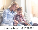 beautiful young mother and her... | Shutterstock . vector #523943452