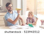 handsome father and his cute... | Shutterstock . vector #523943512