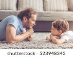 side view of handsome father... | Shutterstock . vector #523948342