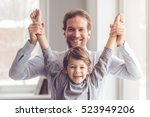 father and son are looking at... | Shutterstock . vector #523949206