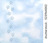 animal foot prints to a snowy.... | Shutterstock .eps vector #523964002