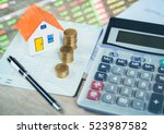 house model and coin on bank... | Shutterstock . vector #523987582