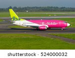 Small photo of DUESSELDORF / GERMANY - SEPTEMBER 2006 DBA Boeing 737-36Q, D-ADIC, cn 30335 / 3129 wearing special T-Mobile colours on its way to runway 23L.