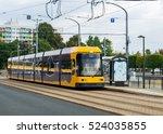 modern yellow tram in dresden... | Shutterstock . vector #524035855