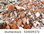A Pile Of Rubble With Bits Of...