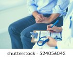 doctor woman sitting with male... | Shutterstock . vector #524056042