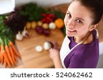 young woman cutting vegetables... | Shutterstock . vector #524062462
