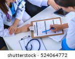 happy medical team discussing... | Shutterstock . vector #524064772