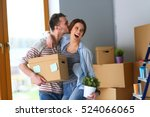Happy Young Couple Unpacking Or ...