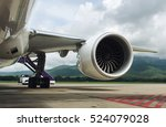 Turbine of engine airplane in airport background. - stock photo