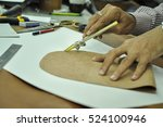 hands of a leather tailor... | Shutterstock . vector #524100946