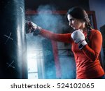 Young Woman Training Punch...