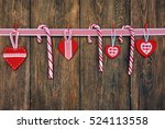 three candy canes and red... | Shutterstock . vector #524113558