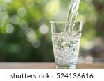 glass of water on nature... | Shutterstock . vector #524136616
