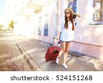 young girl with a suitcase.... | Shutterstock . vector #524151268