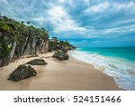 White Sand Beach And Ruins Of...