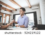 portrait of a man paying using... | Shutterstock . vector #524219122