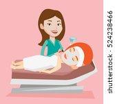 cosmetologist applying facial... | Shutterstock .eps vector #524238466