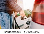 woman refueling her small... | Shutterstock . vector #524263342
