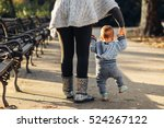 mom teaching her son's first... | Shutterstock . vector #524267122