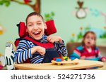 Cheerful Boy With Disability A...