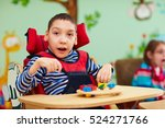 cheerful boy with disability at ... | Shutterstock . vector #524271766