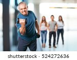 mature man doing exercise with... | Shutterstock . vector #524272636