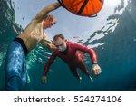 underwater shot of free divers... | Shutterstock . vector #524274106